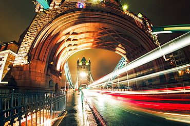 Fisheye view of traffic trail lights on Tower Bridge at night, Southwark, London, England, United Kingdom, Europe