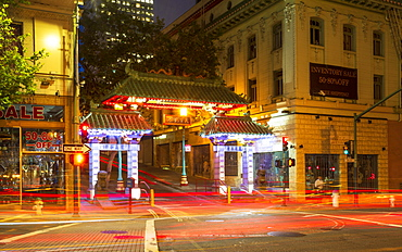 Dragon's Gate and car trail lights at night, Chinatown, San Francisco, California, United States of America, North America
