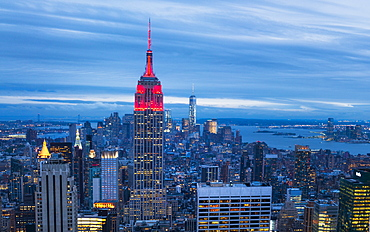 Lower Manhattan skyline from Top of The Rock, Empire State Building at night, New York, United States of America, North America