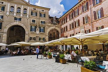 Piazza dei Signori, with crowd eating at restaurants in front of Palazzo Domus Nova on left and Casa della Pieta on right, Verona, Veneto, Italy, Europe