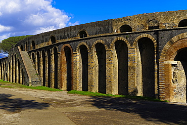 Side entrance to the ruins of the stone built Roman Anfiteatro di Pompeii (Amphitheatre), capacity 20000 people, Pompeii, UNESCO World Heritage Site, Campania, Italy, Europe