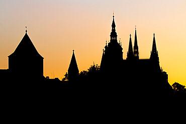 Silhouette of Prague Castle and Saint Vitus Cathedral at sundown, Prague, Czech Republic, Europe