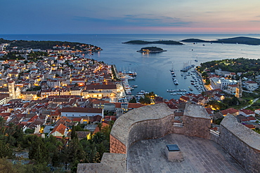 Elevated view over Hvar Town from the Spanish Fortress at dusk, Hvar, Croatia, Europe
