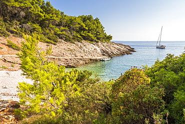 Boat anchoring at Piscena Beach on Hvar Island, Hvar, Croatia, Europe