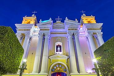 The illuminated Cathedral of Huehuetenango at dusk, Huehuetenango, Guatemala, Central America
