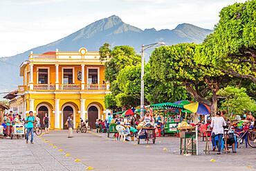 The main square of Granada with view to the Mombacho Volcano in the background, Granada, Nicaragua, Central America