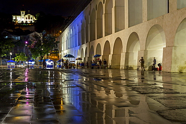 Night shot of the Lapa Arches and the Santa Teresa Convent with reflections on the wet ground shortly after rainfall, Rio de Janeiro, Brazil, South America