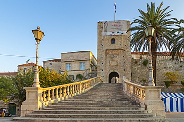 Steps leading up to the entrance gate to the old town of Korcula at first sunlight, Korcula, Croatia, Europe