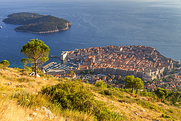 Elevated view over the old town of Dubrovnik and Lokrum Island from the hiking trail up to the lookout atop Srd hill, Dubrovnik, Croatia, Europe