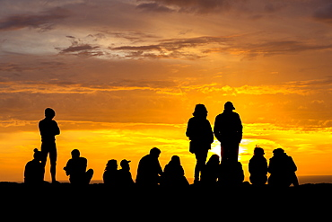 Silhouette of people enjoying sunset at Cape Saint-Vincent, the most southwestern point of Europe, Sagres, Algarve, Portugal, Europe