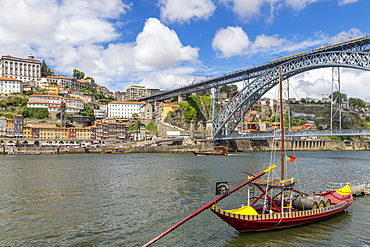Traditional Rabelo boat on Douro River with view to the Dom Luis I Bridge, Porto, Portugal, Europe