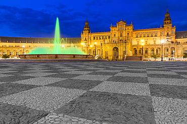 Illuminated fountain and main buildiung at Plaza de Espana at dusk, Seville, Andalusia, Spain, Europe