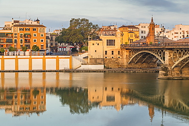 The Triana Neighbourhood seen from the banks of Guadalquivir River at first sunlight, Seville, Andalusia, Spain, Europe
