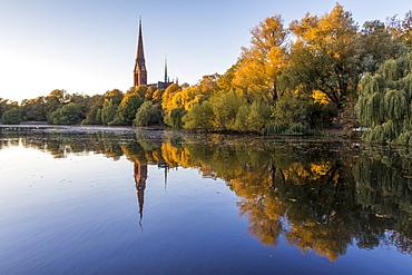 St. Gertrud Church at Kuhmuehlenteich in the Uhlenhorst district during autumn, Hamburg, Germany, Europe