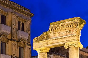 Illuminated entrance gate of the ancient Amphitheatre of Catania at dusk, Catania, Sicily, Italy, Europe