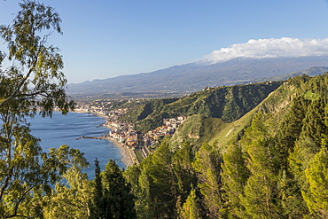 View from the public garden Parco Duca di Cesaro to Giardini Naxos and Mount Etna, Taormina, Sicily, Italy, Europe
