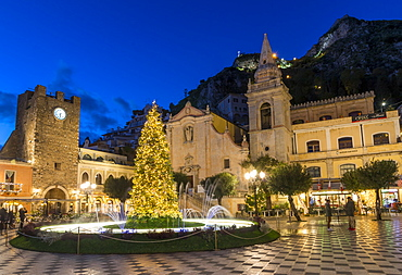 San Guiseppe church and the clock tower gate at Piazza IX Aprile during blue hour, Taormina, Sicily, Italy, Europe