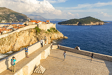 View from Lovrijenac Fortress to the city walls of the old town of Dubrovnik and Lokrum Island, Dubrovnik, Croatia, Europe