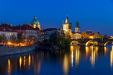 View over Charles Bridge, Old Town Bridge Tower and Vltava River at dusk, Prague, Bohemia, Czech Republic, Europe