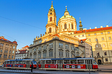 The famous tram no. 22 passing the Malostranske Namesti Square and St Nicholas Church, Prague, Bohemia, Czech Republic, Europe