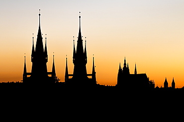 Silhouettes of Our Lady before Tyn Church and St. Vitus Cathedral at sunset, UNESCO World Heritage Site,Prague, Bohemia, Czech Republic, Europe