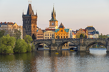 View over Charles Bridge, Old Town Bridge Tower and Vltava River at last sunlight, UNESCO World Heritage Site, Prague, Bohemia, Czech Republic, Europe