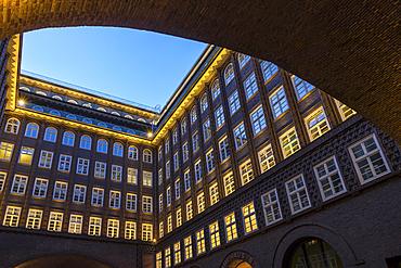 Illuminated Chilehaus, part of the Kontorhaus District, at dusk, UNESCO World Heritage Site, Hamburg, Germany, Europe