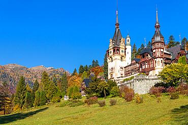 Peles Castle in the Bucegi Mountains Natural Park during autumn, Sinaia, Romania, Europe