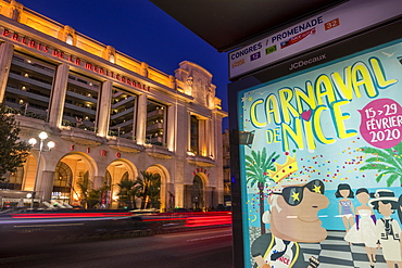 Advertisement for the Nice Carnival at a bus stop near the Palais de la Mediteranee, Nice, Cote d'Azur, French Riviera, Provence, France, Europe