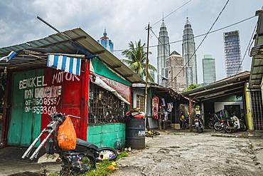 Side street in Kampung Baru with the Petronas Twin Towers in the background, Kuala Lumpur, Malaysia, Southeast Asia, Asia