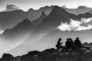 A group of trekkers relaxing after a long day at New Shira Camp on the Machame Route up Mount Kilimanjaro, with the Shira Ridge in the background, Tanzania, East Africa, Africa
