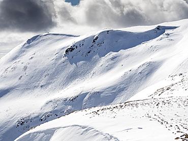 Fresh avalanche debris on Carn nan Sac, 920m, on the hills above Glenshee ski centre in the Cairngorm National Park, Scotland, United Kingdom, Europe