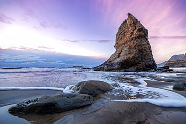 A Sea stack with a subtle sunset on the ocean, Newport, Oregon, United States of America