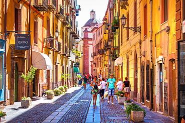 People walking along street in Bosa, Sardinia, Italy, Europe