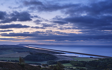 Portland, the sweep of Chesil Beach, the inland lagoon the Fleet seen from the hill at Abbotsbury, near Weymouth, Dorset, England, United Kingdom, Europe