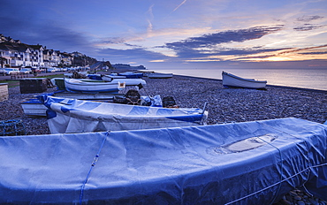 Serene dawn scene of fishing boats on the pebbled beach at Budleigh Salterton, Devon, England, United Kingdom, Europe