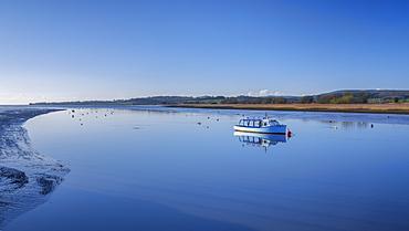 Turf Ferry moored on a mirror calm River Exe at Topsham, Devon, England, United Kingdom, Europe