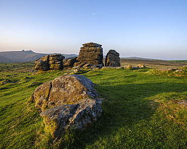 Warm sunlight on granite at Hound Tor in Dartmoor National Park, Bovey Tracey, Devon, England, United Kingdom, Europe