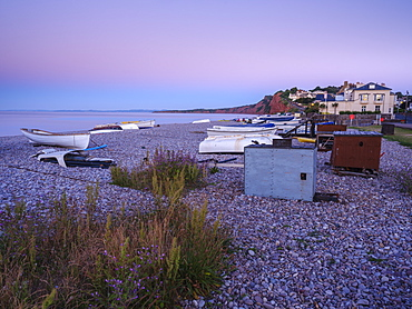 A lilac twilight with boats on the pebbled beach at Budleigh Salterton, Devon, England, United Kingdom, Europe