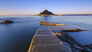 Sunrise on the boat jetty with warm light at St. Michael's Mount in Marazion, Cornwall, England, United Kingdom, Europe