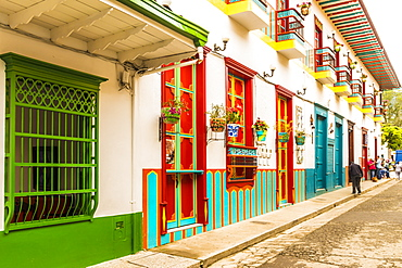 A colourful street scene with its preserved and colonial buildings, Jardin, Colombia, South America
