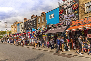 Some of the typically colourful stores on Camden High Street in Camden, London, England, United Kingdom, Europe