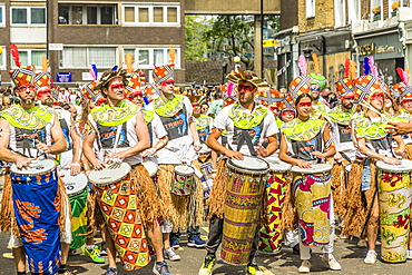 Some of the colourfully dressed drummers at the Notting Hill Carnival, London, England, United Kingdom, Europe