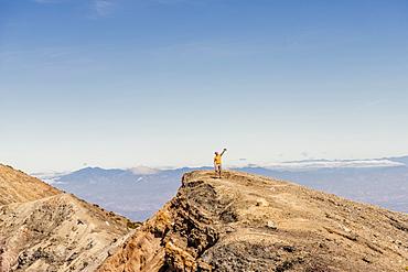 A tourist taking a selfie on top of the Santa Ana Volcano (Ilamatepec) in Santa Ana, El Salvador, Central America