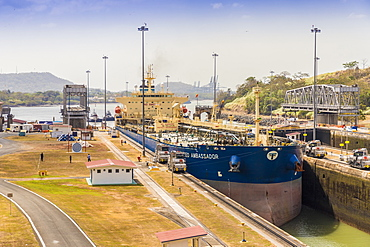 A ship passing through the Panama Canal at the Miraflores locks in Panama City, Panama, Central America