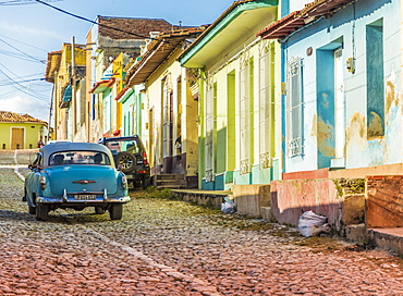 A car in a colourful colonial street in Trinidad, UNESCO World Heritage Site, Cuba, West Indies, Caribbean, Central America