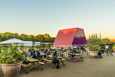 People relaxing in Hyde Park with The London Mastaba sculpture in the background, London, England, United Kingdom, Europe
