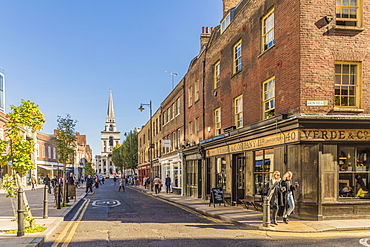 Beautiful old shops on Brushfield Street, with Christ Church in the background, in Spitalfields, London, England, United Kingdom, Europe