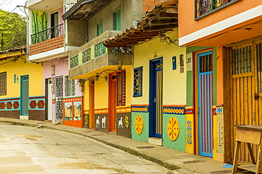 A typically colourful street with traditional buildings in the picturesque town of Guatape, Colombia, South America