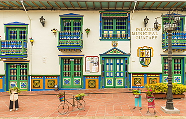 The colourful facade of the Palacio Municipal (City hall and tourist office), in the picturesque town of Guatape, Colombia, South America